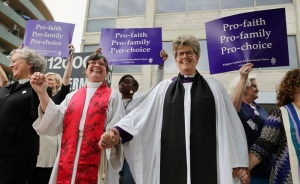 Blessing abortion clinic. Click to go to article. One day, God will wipe those Satanic smiles from these faces.